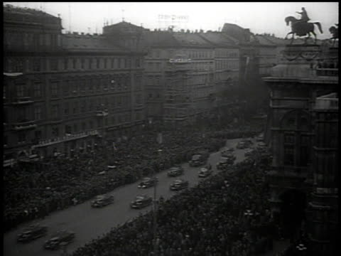 hitler's motorcade arriving in vienna and thousands of people line the streets cheering and waving / austria - vienna austria stock videos & royalty-free footage