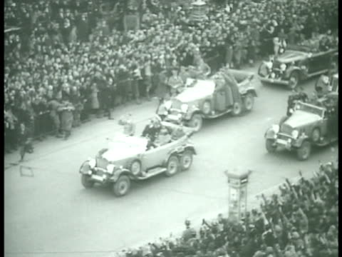 hitler's motorcade w/ people lining street w/ hitler standing in front car saluting passing crowds lining road - drittes reich stock-videos und b-roll-filmmaterial