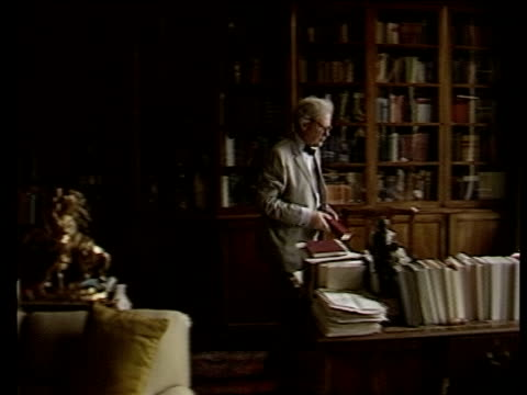 vidéos et rushes de hitler's secret diaries two men sentenced for forgery england cambridge hugh trevorroper takes book from shelf and walks lr to desk and sits ms... - book