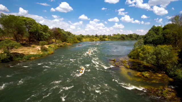 hitting the zambezi rapids - inflatable raft stock videos and b-roll footage