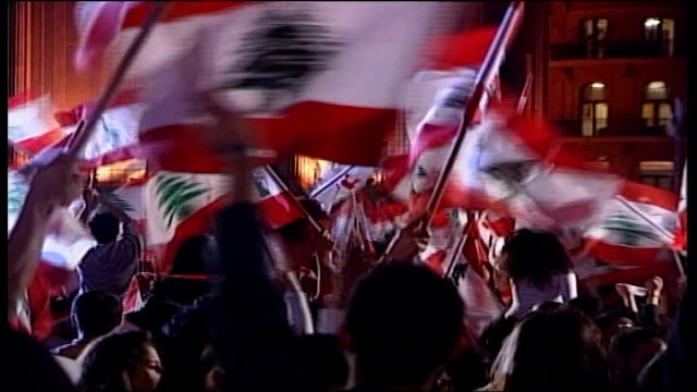 hizbollah antigovernment protests tx crowds waving lebanese flags during street demonstrations following withdrawl of syrian troop sfrom lebanon - hezbollah stock videos & royalty-free footage