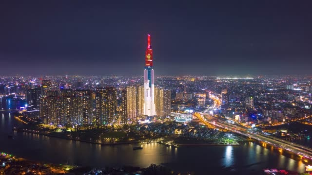 ho chi minh city, vietnam - the landmark81 with flag of vietnam on the top to celebrate national reunification day - april 30, 2020 - aerial view - this year not fireworks because of covid -19 - anniversary stock videos & royalty-free footage