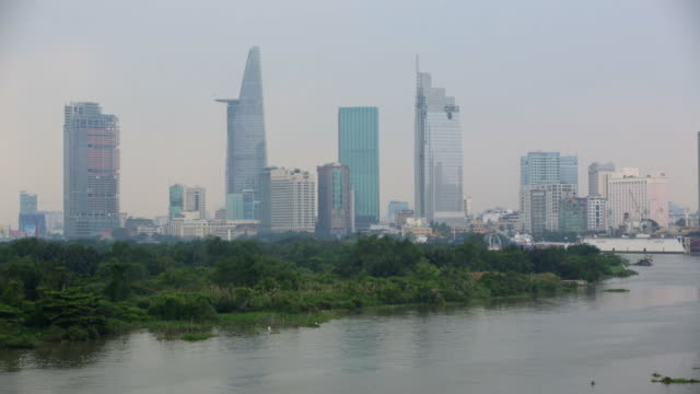 ws ho chi minh city with the saigon river in the fore ground. - vietnam meridionale video stock e b–roll