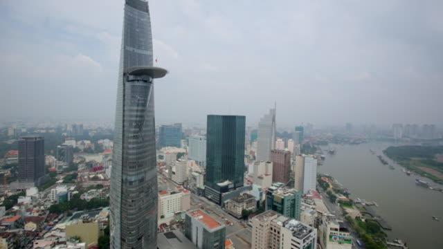 ws pan ho chi minh cityscape with the saigon river, vietnam. - vietnam meridionale video stock e b–roll
