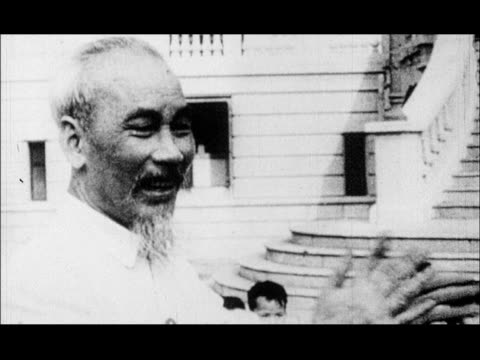 ho chi minh leading children in singing and clapping / american soldiers posing with dead bodies / jet being shot down anti-aircraft fire - dead stock videos & royalty-free footage
