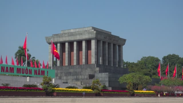 ho chi minh memorial mausoleum at hanoi, vietnam. red communist and vietnamese flags waving - former ussr flag stock videos & royalty-free footage