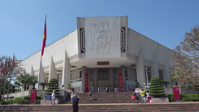 Ho Chi Minh Museum entrance. Next to mausoleum at Hanoi, Vietnam. Red communist and Vietnamese flags waving