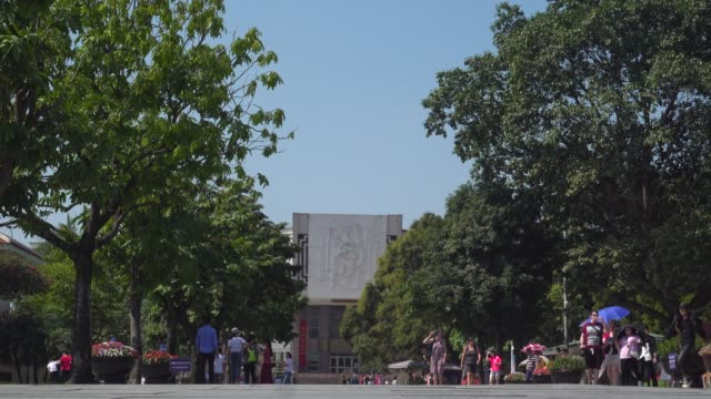 ho chi minh museum next to mausoleum at hanoi, vietnam. red communist and vietnamese flags waving - traditionally vietnamese stock videos & royalty-free footage