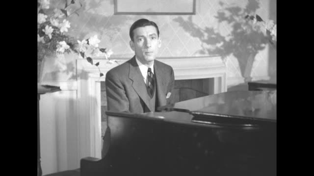 hoagy carmichael seated at grand piano plays and sings stardust in parlor of a house / note exact year not known documentation incomplete - hoagy carmichael stock videos & royalty-free footage