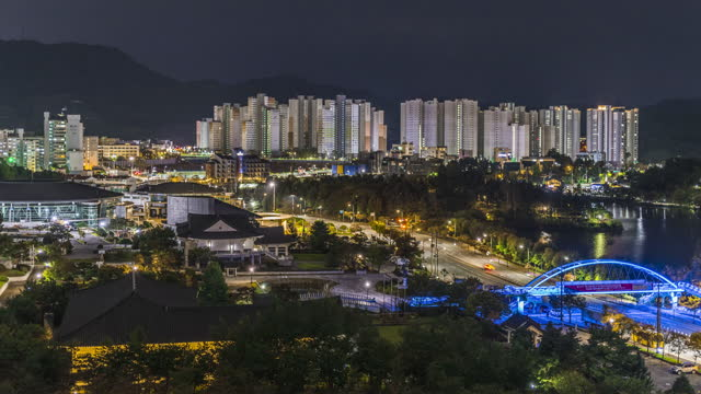 hoamji pond and ureukdang national classical music center with city buildings at night / chungju-si, chungcheongbuk-do, south korea - general motors stock videos & royalty-free footage