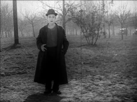 B/W 1925 hobo (Harry Langdon) suddenly getting stung + falling on buttocks / feature