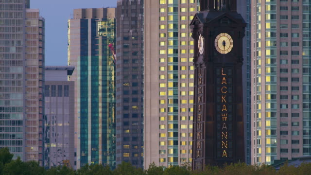 hoboken clock tower against jersey city skyline - clock tower stock videos & royalty-free footage