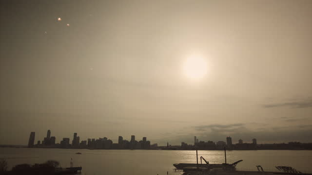 hoboken new jersey from new york city during sunset with sun - orange new jersey stock videos & royalty-free footage