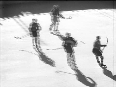 stockvideo's en b-roll-footage met / hockey game between great britain winners of 1936 hockey competition and nazi germany team. ice hockey at the 1936 winter olympics on february 12,... - 1936