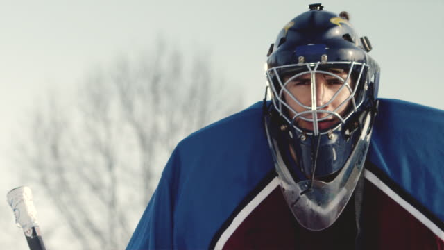 sm ms portrait hockey goalie in facemask with trees behind him/ long island, ny - goalkeeper stock videos & royalty-free footage
