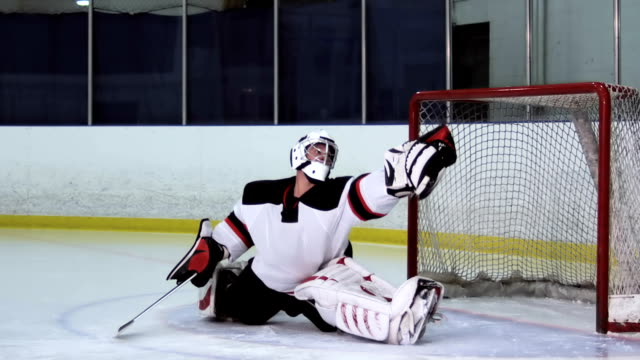 hockey player goalie glove save - hockey glove stock videos & royalty-free footage