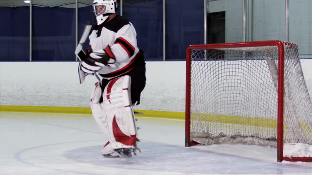 hockey player goalie glove saves - hockey glove stock videos & royalty-free footage