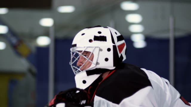 hockey player goalie - hockey glove stock videos & royalty-free footage