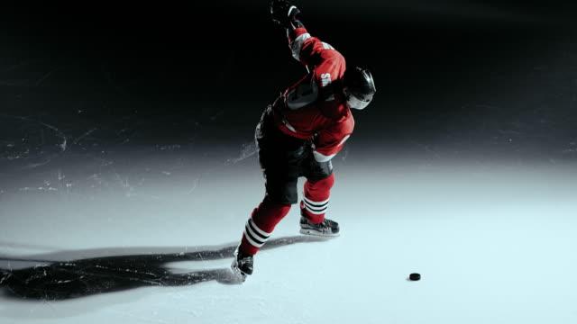 SLO MO LD Hockey player performing a shot