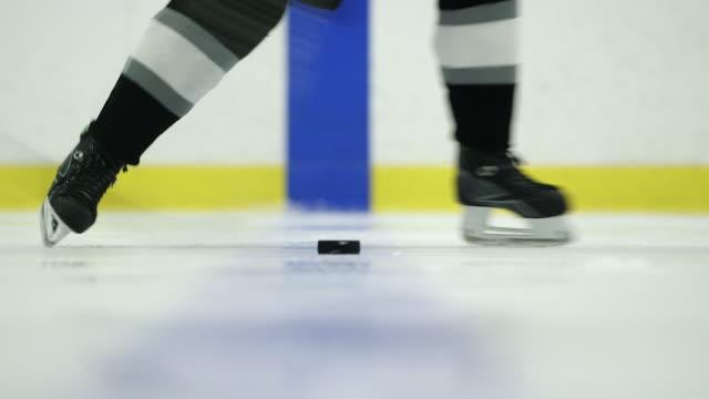 CU of hockey player practicing his slapshot