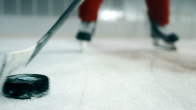 hockey player preparing for a shot 4k - winter sport stock videos and b-roll footage