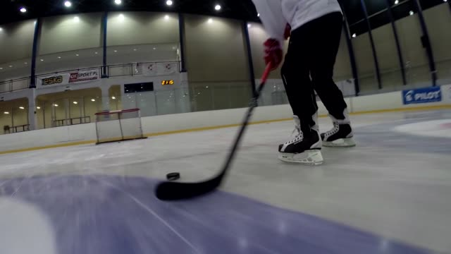hockey player striking the puck into goal - hockey glove stock videos & royalty-free footage