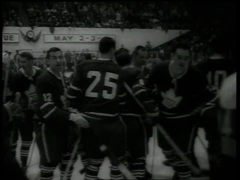 vídeos de stock e filmes b-roll de hockey players on ice / crowds cheer / team presented with stanley cup trophy - campeonato desportivo
