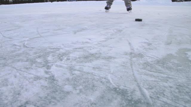 hockey puck pass to camera - ice stock videos & royalty-free footage
