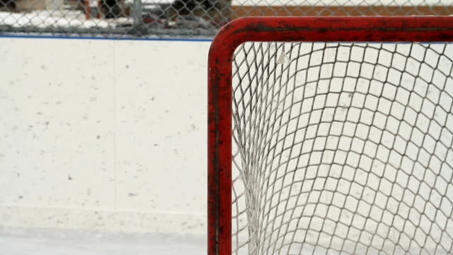 hockey pucks shot into empty net - netting stock videos & royalty-free footage