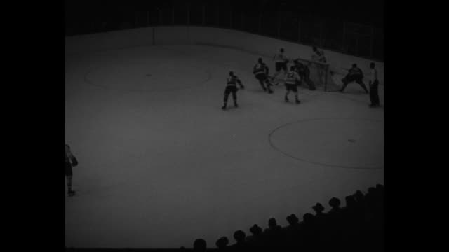 WS hockey rink with Chicago Blackhawks and Montreal Canadiens lined up and facing each other on the ice / MS face off / WS puck hit into Canadiens'...