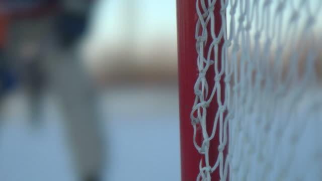 hockey scene winter - ice hockey stock videos and b-roll footage