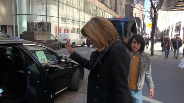 hoda kotb greets fans while departing from rockefeller center on april 01, 2014 in new york city. - hoda kotb stock videos & royalty-free footage