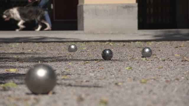 hofgarten, boule balls lying on earth - human limb stock videos & royalty-free footage