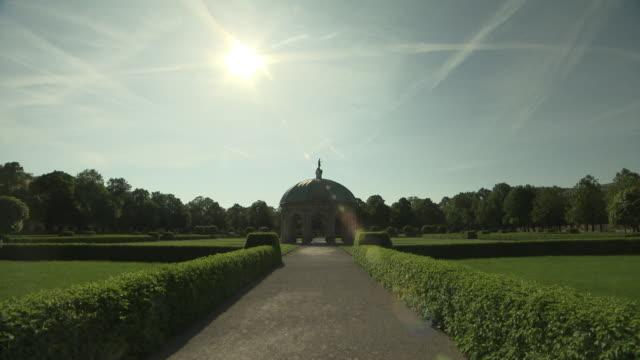 hofgarten, park,  pagode, bushes, lawn, blue sky, sun  - pagode stock videos & royalty-free footage