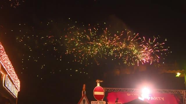 Hogmanay celebrations in Edinburgh SCOTLAND Edinburgh Fireworks above crowd and 'Street Party' sign