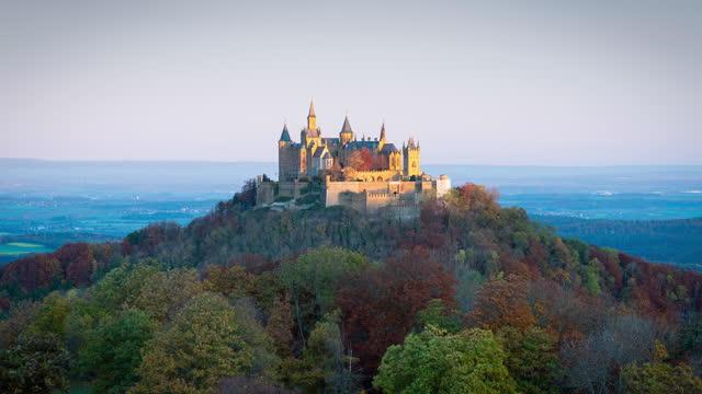 hohenzollern castle autumn sunrise time lapse burg hohenzollern germany 4k - castle stock videos & royalty-free footage