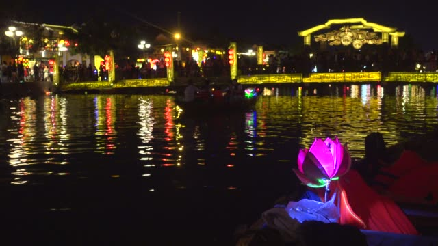 hoi an vietnam full moon celebration. boats with illuminated lotus flower shaped lanterns. cau an hoi bridge illuminated at night. unesco world heritage - traditionally vietnamese stock videos & royalty-free footage