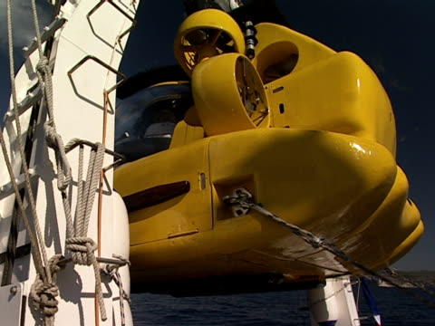 hoists pull an underwater exploration boat. - hoisting stock videos & royalty-free footage