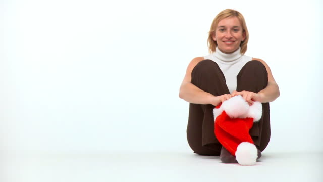 hd: holding a santa hat - santa hat stock videos & royalty-free footage