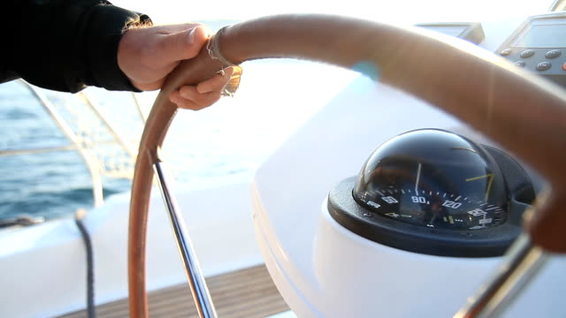 stockvideo's en b-roll-footage met hd: holding a wheel while sailing - jachtvaren