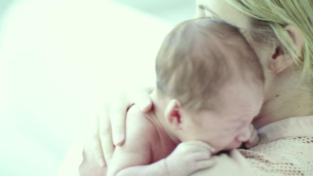 Holding Baby On Shoulder
