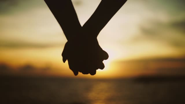 holding hand. - holding hands stock videos & royalty-free footage