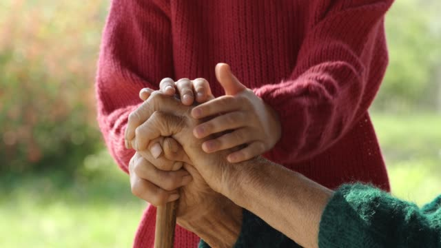 holding hands. detail of a child's hands holding the senior woman hands - hands clasped stock videos & royalty-free footage