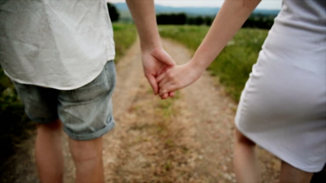 Holding hands. Slow motion