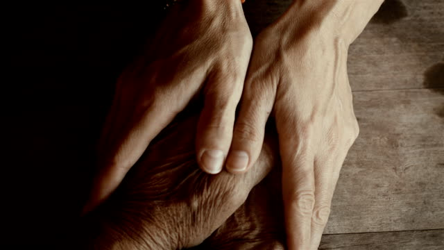 holding hands - senior adult stock videos & royalty-free footage