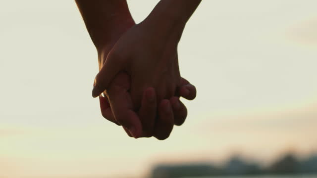 holding hands. - holding hands stock videos & royalty-free footage