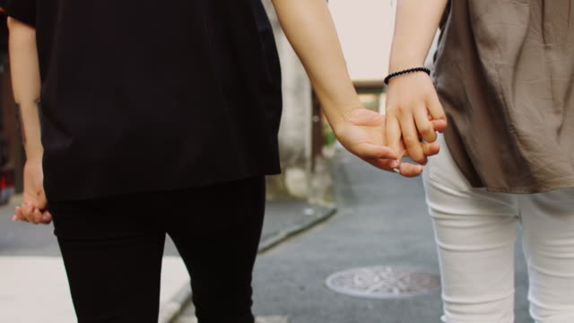holding hands - holding hands stock videos & royalty-free footage