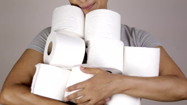 holding pile of toilet paper - large group of objects stock videos & royalty-free footage
