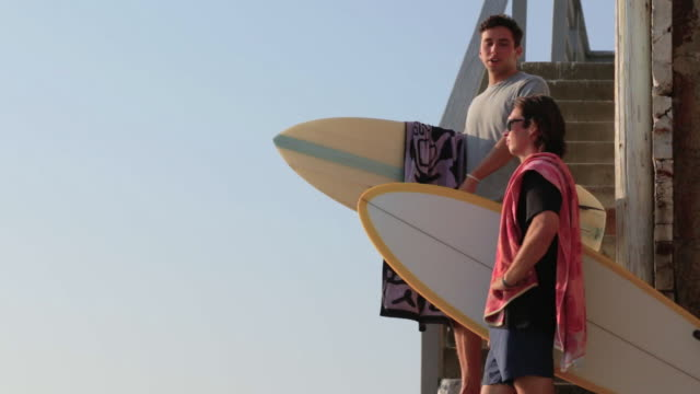 Holding surfboard