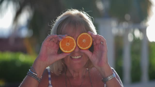 holding up sliced oranges - unrecognisable person stock videos and b-roll footage